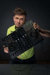 DJ posing with mixer