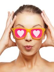 surprised teenage girl in pink sunglasses