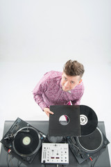 Top view portrait of dj showing his vinyl records standing by tu