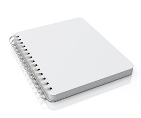 empty spiral notebook lying isolated on white background