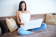 Young woman working from home on a laptop