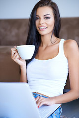 Young woman enjoying a cup of espresso coffee