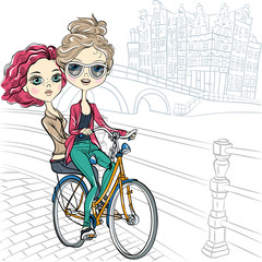 Vector cute girls on the bike in Amsterdam
