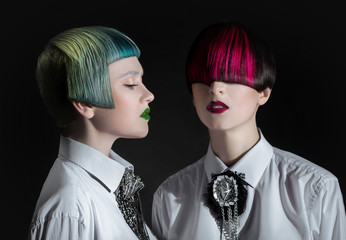 Dark portrait of pale gothic women with creatively dyed hair