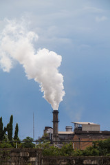 Industrial smoke from chimney to sky