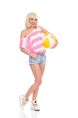 Blond girl with a beach ball