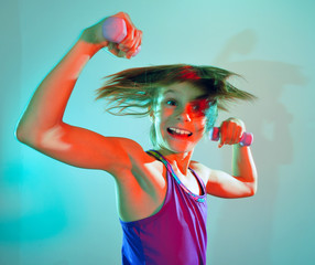 child exercising with dumbells