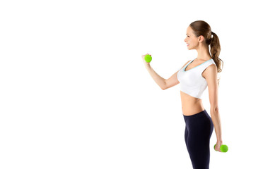 Young girl with dumbbells on a white background