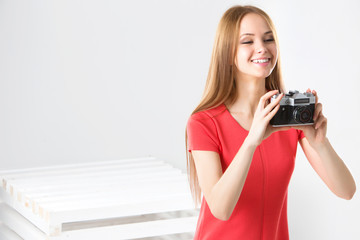 Happy smiling stylish teenager with vintage camera