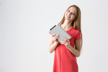 Happy brunette woman holding tablet