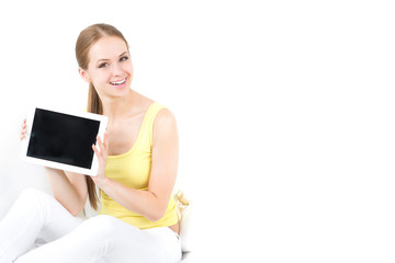 beautiful girl sitting and shows the electronic tablet