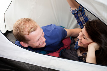 Couple lying down in the tent