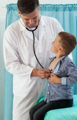 Pediatrician examining little boy