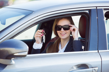 woman in the new car with keys