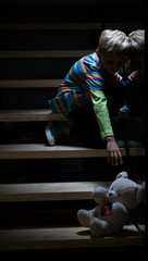 Boy on stairs at night
