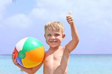 Happy boy with beach ball