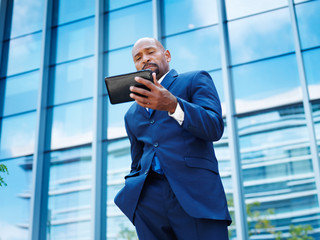 african businessman wokring on a tablet