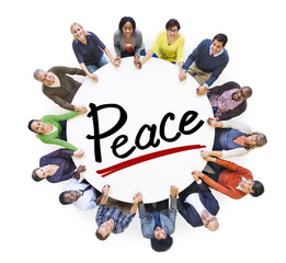 Group of People Holding Hands Around Letter Peace