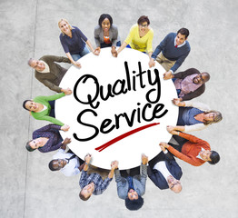 People Holding Hands Around Quality Service