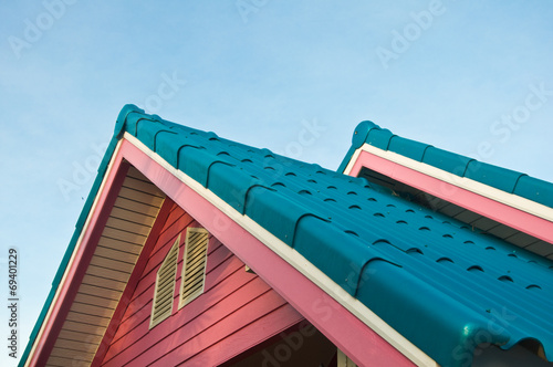 Roof of a new wooden house with a blue sky