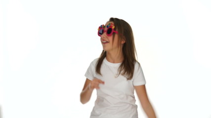 Smiling happy young girl in funky sunglasses