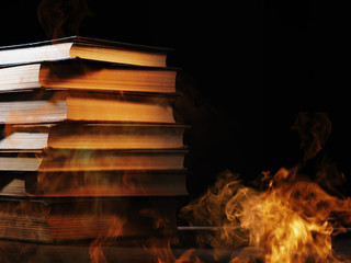 Hardcover books with swirling smoke