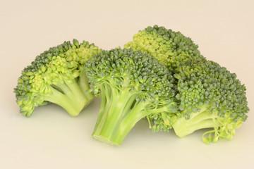 Fresh cut raw Broccoli on creamy background