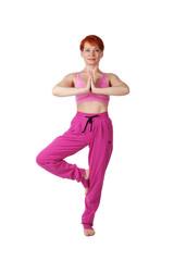 elderly woman standing in yoga pose
