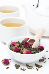 green tea with rosebuds, cups and teapot, vertical