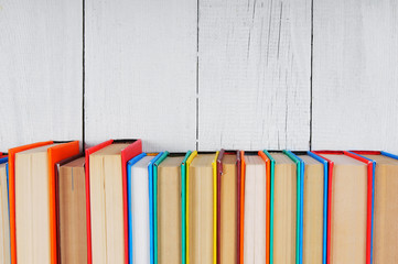 Books. On wooden, white background.
