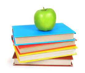 Books and an apple. On white background.