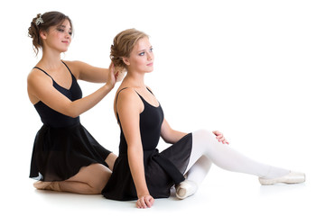 Two beautiful young dancers preparing for training together isol