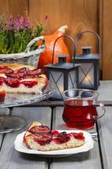 Plum pie in autumn party setting