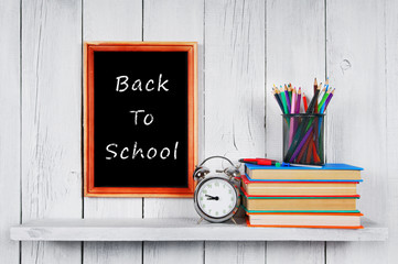 Back to school. Frame. Books and school tools.
