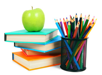 Books, an apple and pencils. On white background.