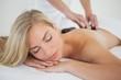 Zdjęcia na płótnie, fototapety, obrazy : Beautiful blonde enjoying a hot stone massage