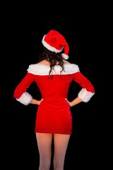 Pretty brunette in santa outfit posing with hands on hips