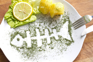 Silhouette fish in dill on plate abstract food concept