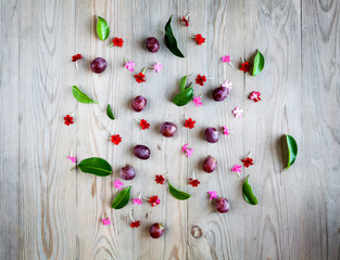 Red grapes with flowers on wooden board