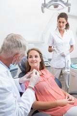 Dentist examining a patients teeth