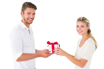 Attractive young couple holding a gift