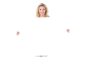 Pretty young blonde showing poster