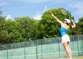 Tennis player about to serve