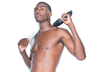 Portrait of a fit shirtless man holding frying pan