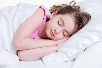 Adorable little girl sleeps.
