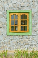 wooden window with stone wall