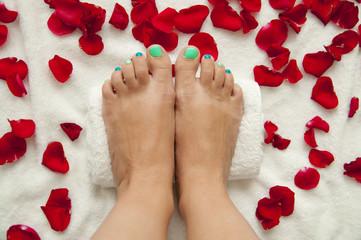 Pedicure in a beauty salon - woman feet ready for treatment