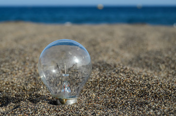 Light bulb on the beach