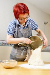 Pour dough on table