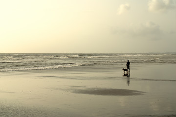 Walking the dog on the beach